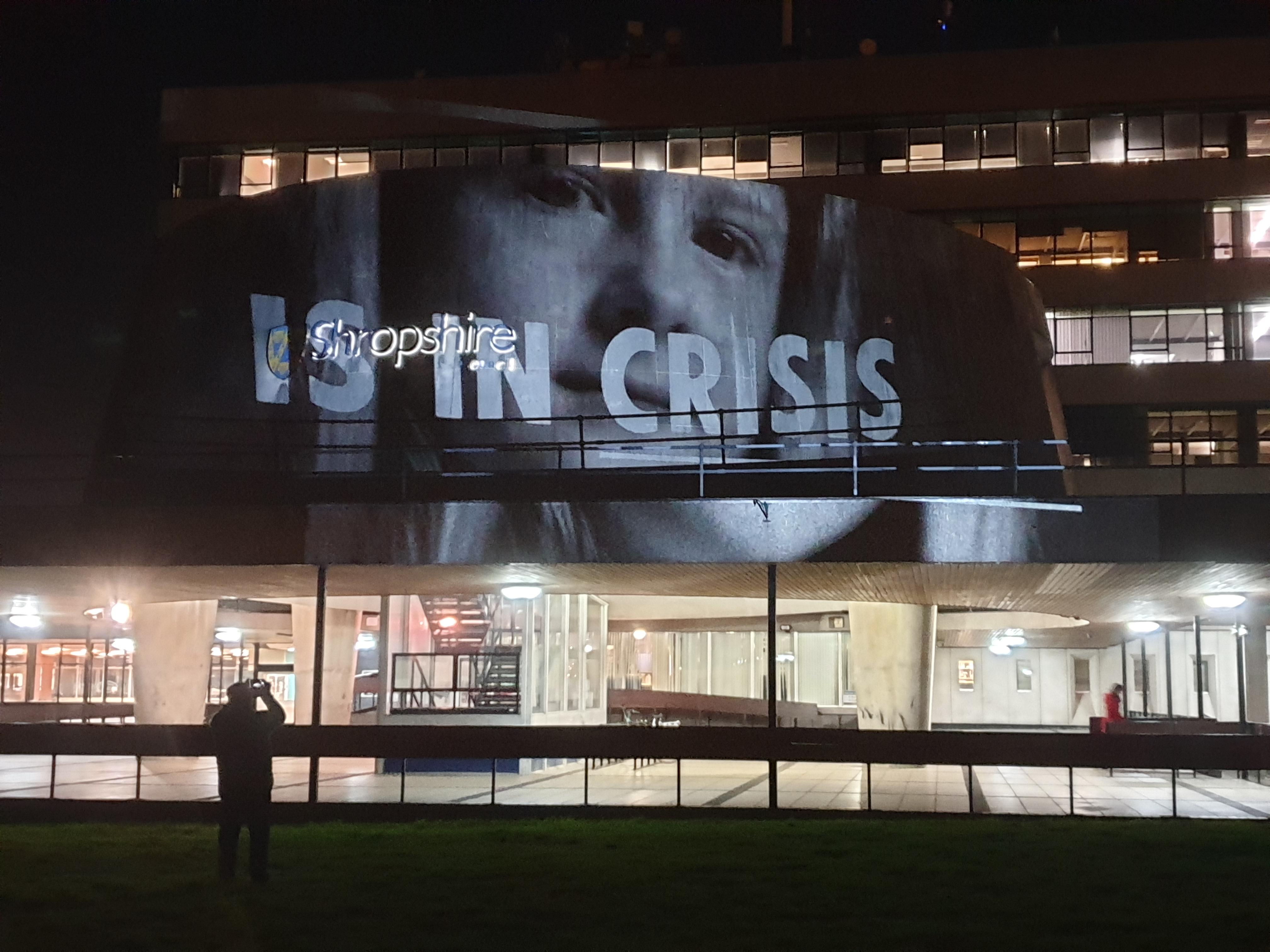 Activists project climate change film onto Shropshire Council headquarters